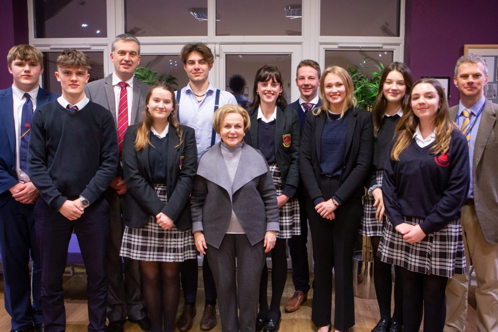 Mala Tribich, MBE with staff and students of Churcher's College. Picture: Churcher's College